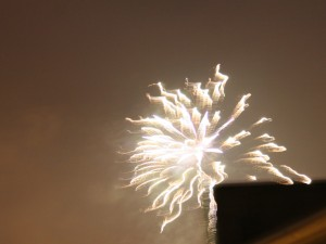 Firework over rooftop